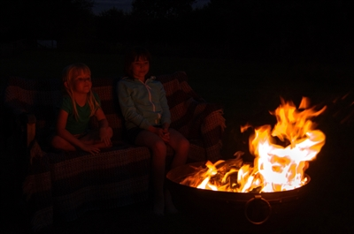 Family sitting by the fire pit